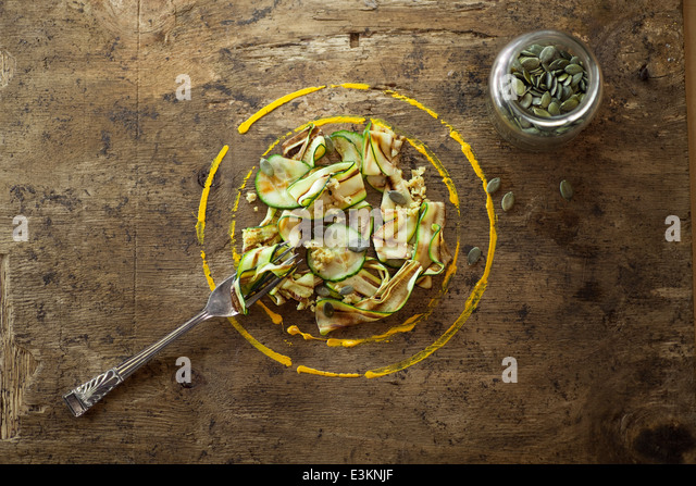Courgette Ribbon Salad With Pumpkin Seeds. - Stock Image