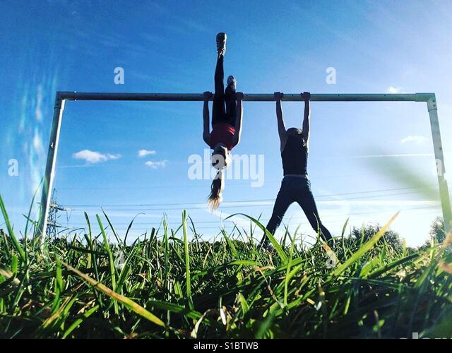 2 girls doing gymnastics - Stock-Bilder