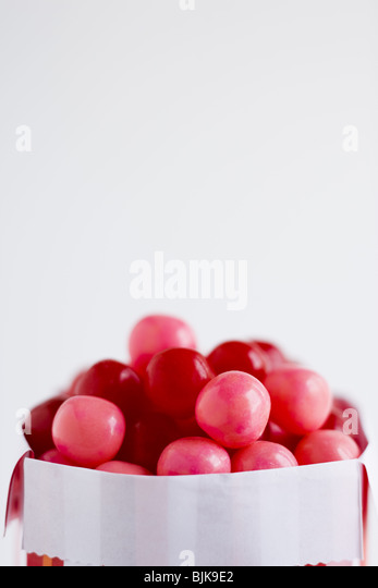 Candy box with pink and red candies - Stock Image