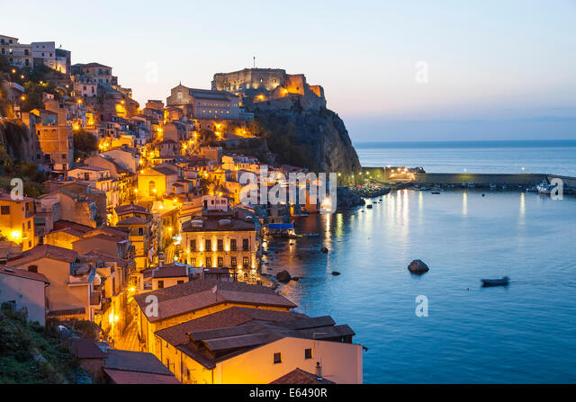 Town View at dusk, with Castello Ruffo, Scilla, Calabria, Italy - Stock Image