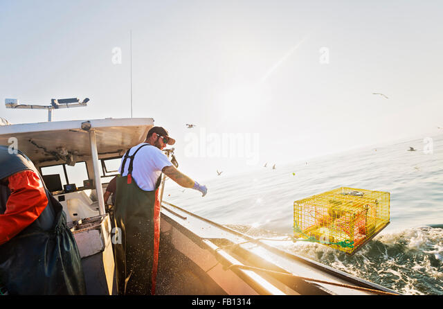 Fisherman working on fishing boat - Stock Image