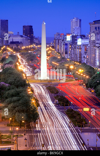 Aerial view of 9 de Julio Avenue, with Obelisco Monument, at night, with car lights traces. Buenos Aires, Argentina - Stock-Bilder