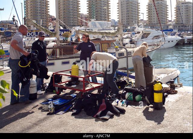 Divers preparing gear, Marina Bay, Gibraltar - Stock Image