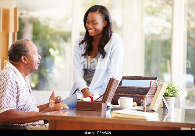 Senior Father Discussing Document With Adult Daughter - Stock-Bilder