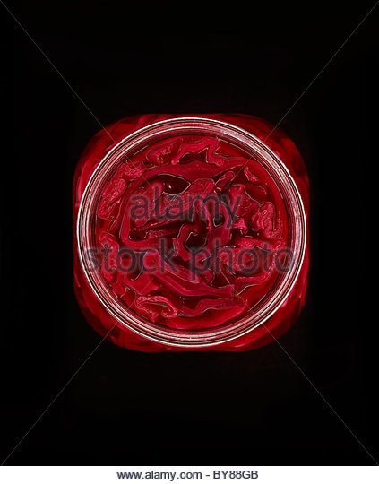 Close up of red pickled cabbage in jar - Stock Image