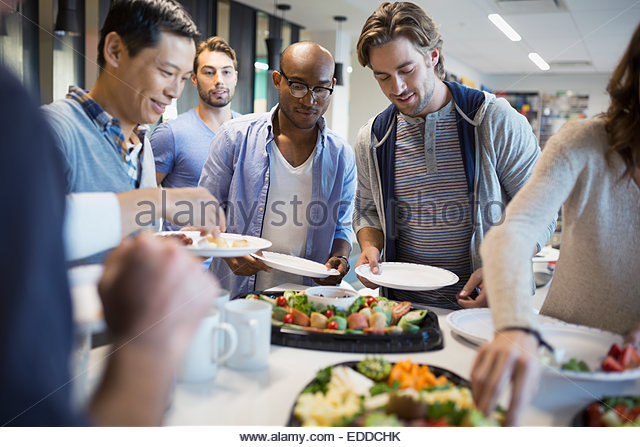 Business people at buffet table - Stock Image