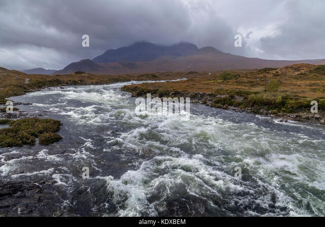 A fast flowing river in the Cuillin Hills on the Isle of Skye in the Inner Hebrides of northwest Scotland. - Stock Image