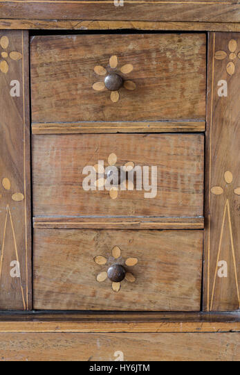 Drawers background, detail on old weathered wooden furniture - Stock Image
