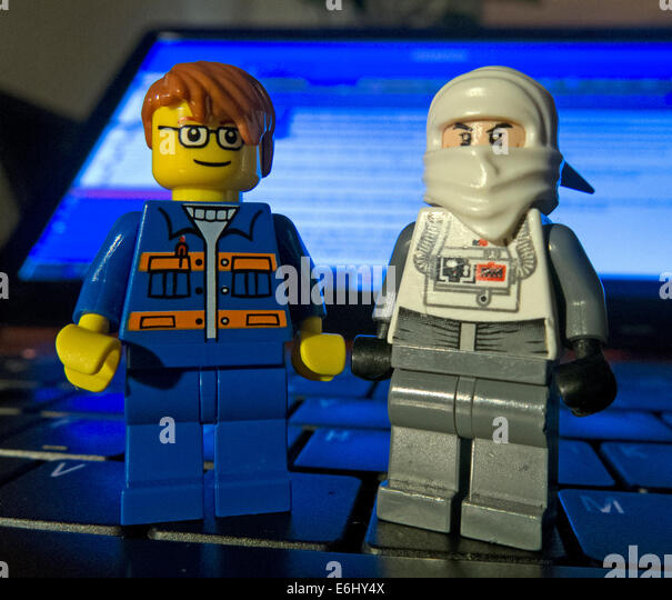 Two Lego men on a laptop keyboard - Stock Image