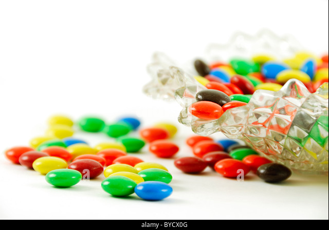 A close-up of a candy dish with candy coated candies. - Stock Image