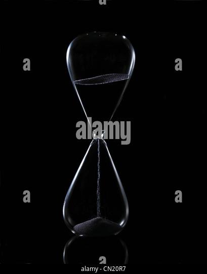 Hour glass on black background - Stock-Bilder