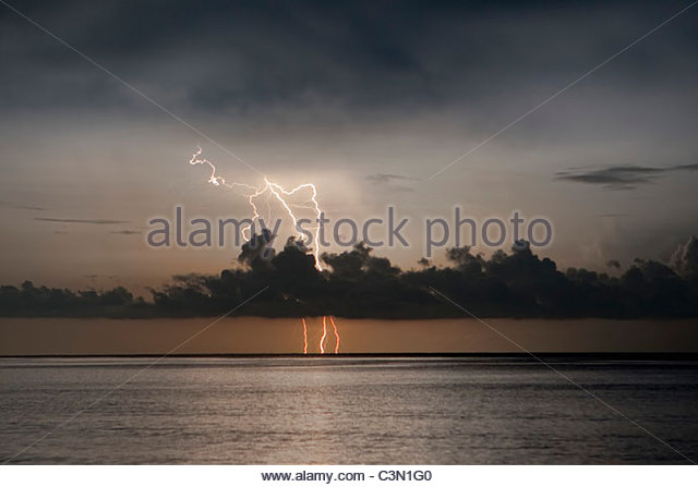 Indonesia, Island Bali, near Tejakula village, Gaia Oasis Resort. Sunrise. Lightning at horizon. - Stock Image