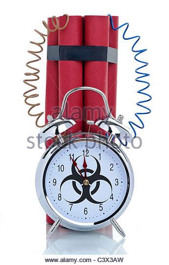 Time bomb, alarm clock with biohazard sign and dynamite sticks, symbolic image - Stock Image