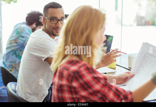 People working at conference table - Stock Image
