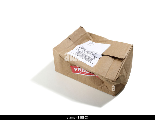 Beat up Cardboard shipping Box - Stock Image