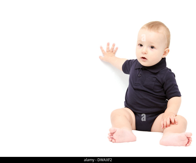 baby showing with hand on white background - Stock Image