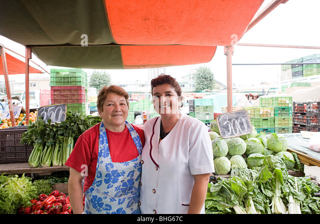 Two female traders on vegetable stall - Stock Image
