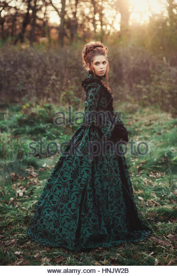 Victorian woman at sunset - Stock Image