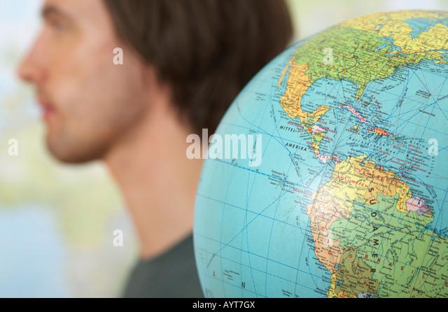 A Man beside a globe - Stock Image