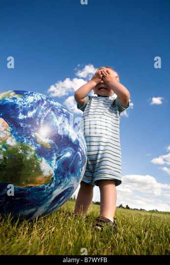 Child playing with ball - Stock Image