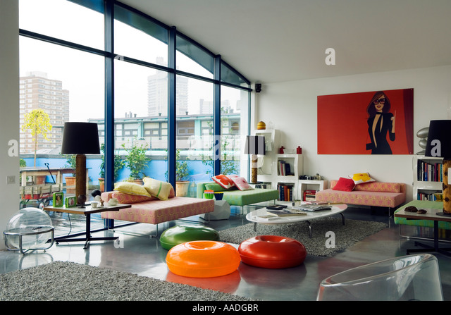 Open-plan living area in contemporary roof apartment - Stock Image