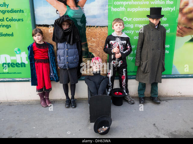 Children with Guy Fawkes at Whitby Goth Weekend, November 2013, Whitby, North Yorkshire, England, UK - Stock Image