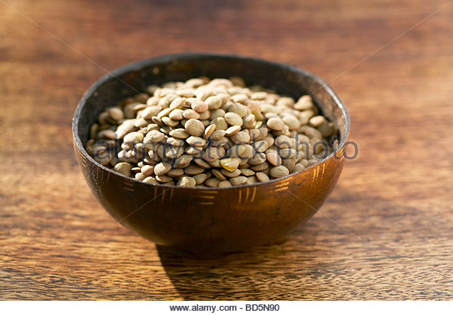 Green lentils in a small bowl - Stock Image