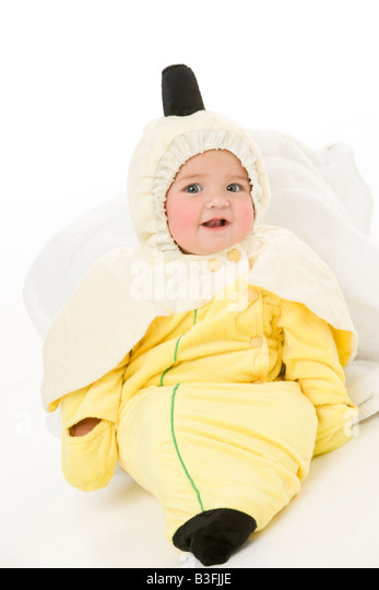 Baby in banana costume - Stock Image