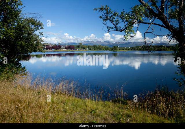 Summer scenic of Westchester Lagoon in downtown Anchorage, Southcentral Alaska, Summer - Stock Image