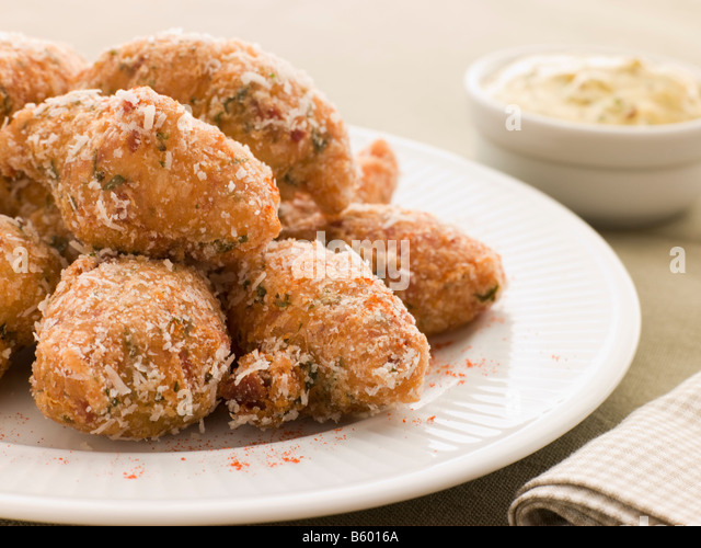 Ham and Cheese Beignets with Dijonnaise - Stock Image