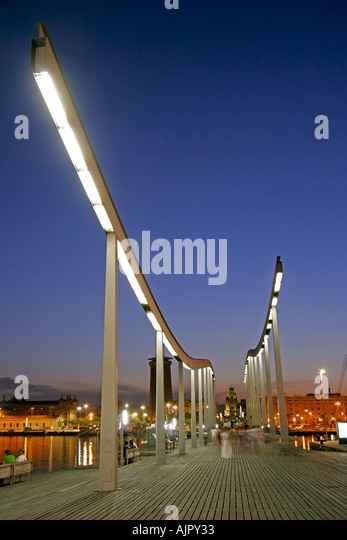spain Barcelona Port Vell Rambla del Mar walkway dusk - Stock Image