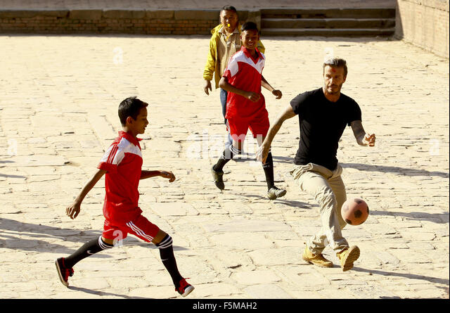 Kathmandu, Nepal. 6th Nov, 2015. English soccer star David Beckha plays football in a charity match to collect funds - Stock Image
