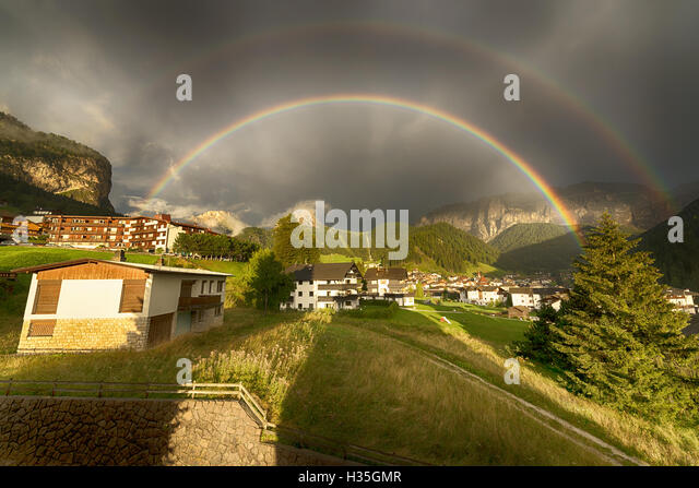 Rainbow after the thunderstorm over the Selva di Val Gardena in a summer end of the day, Trentino-Alto Adige - Italy - Stock Image