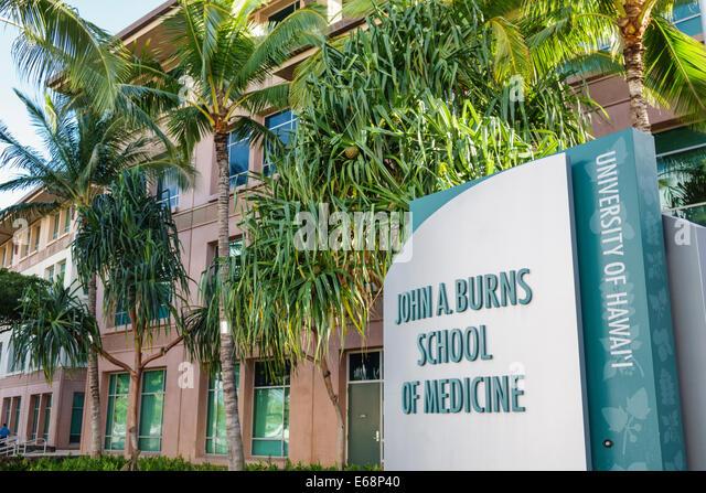 Hawaii Hawaiian Honolulu University of Hawaii John A. Burns School of Medicine sign building campus - Stock Image