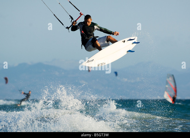 a kitesurfer in action - Stock Image