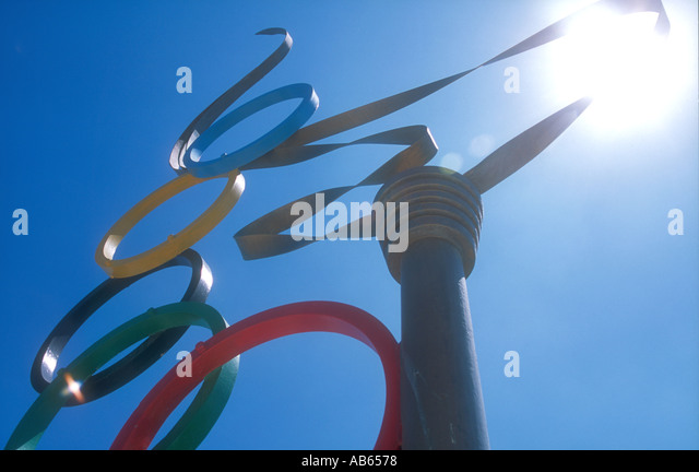 A sculpture of the Olympic Torch with the Olympic rings symbol in Alimos, Athens, Greece. - Stock Image