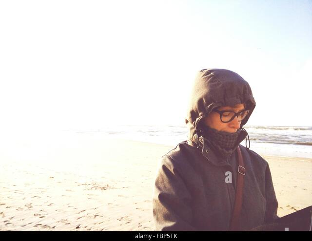 Woman In Spectacles On Beach - Stock Image