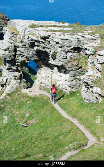 Female hiker on the South West Coast Path at Ladies Window near Boscastle in Cornwall, England, UK - Stock Image