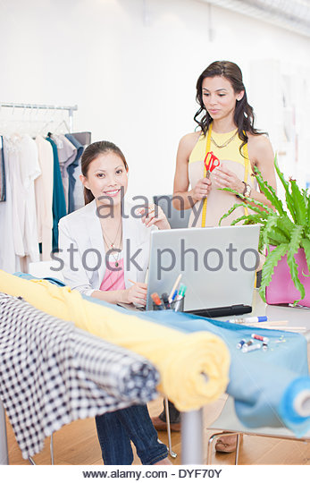 Portrait of fashion designers in office - Stock Image