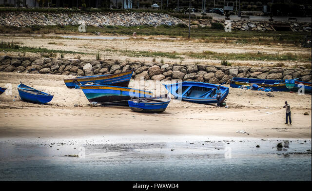Blue beached fishing boats. Morocco - Stock Image