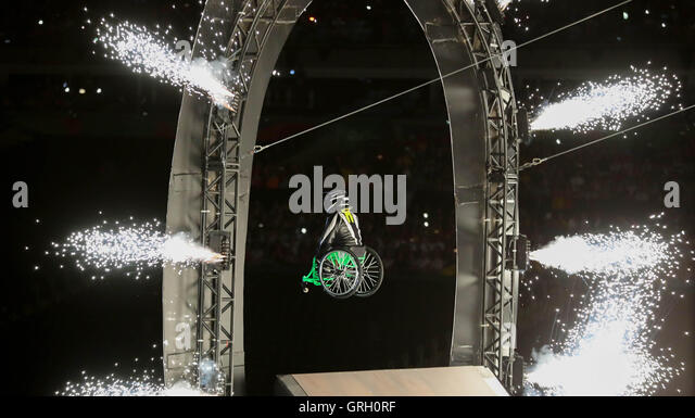 Wheelchair user Aron Wheelz jumps through fireworks at Maracana Stadium during the Opening Ceremony of the Rio 2016 - Stock-Bilder