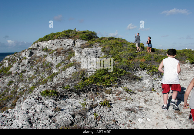 Grand Turk Hawknest Plantation Gun Hill dune buggy excursion tour rocky trail hikers - Stock Image