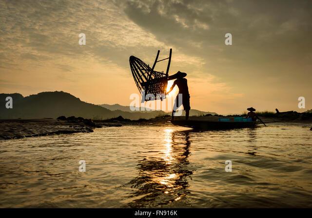 Two fishermen fishing on Mekong River, Laos - Stock Image