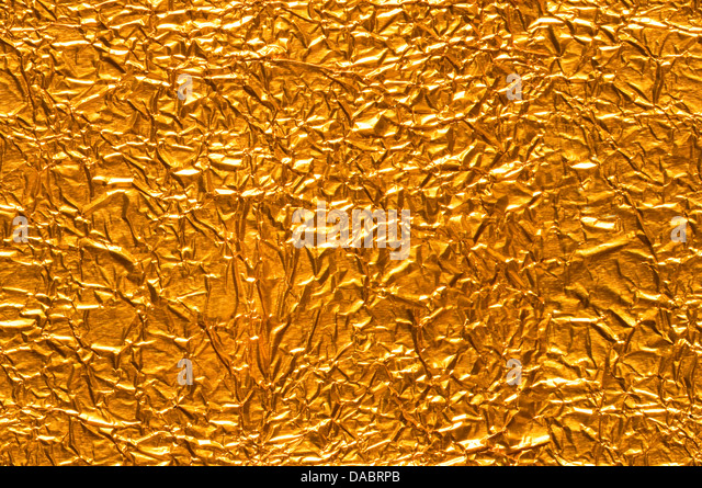 Gold Foil Background Seamlessly tileable - Stock Image