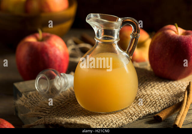 Raw Organic Apple Cider Vinegar in a Bottle - Stock Image