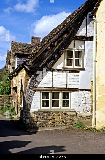 Rare partly exposed cruck frame at end of a period cottage in Lacock Chippenham Wiltshire UK - Stock Image