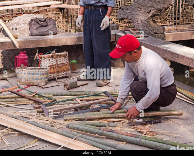 Suzhou, China, Asia, Humble Administrator's Garden; Sorting out Bamboo Sticks - Stock Image