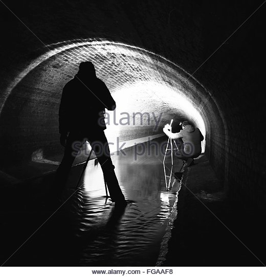 Men Photographing In Sewage - Stock-Bilder