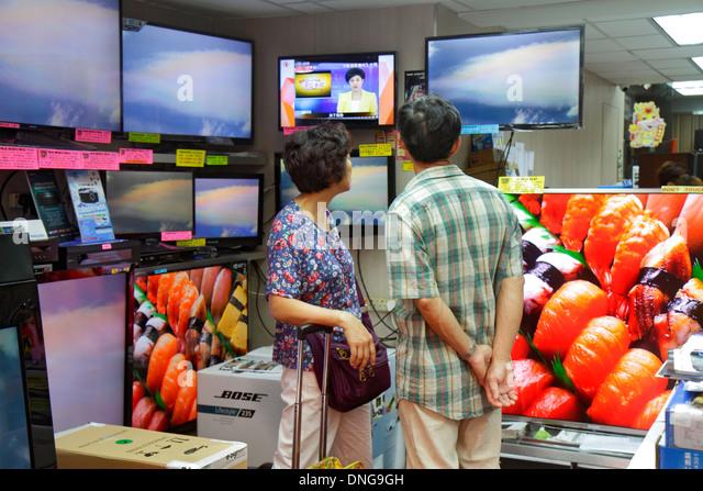 Hong Kong China Kowloon Sham Shui Po shopping electronics store large flat panel television TV sale display Asian - Stock Image