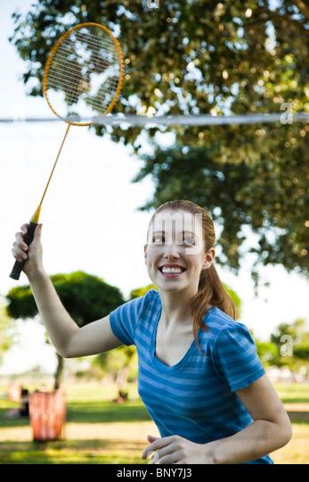 Teen girl playing badminton - Stock Image